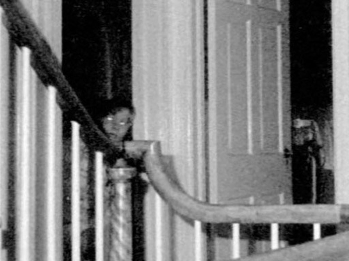 A ghostly figure seen peering out from a doorway. This was taken with infrared film during an investigation after the Lutz family fled the house.