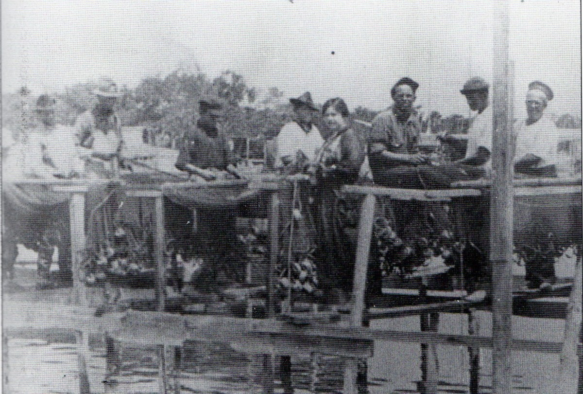 Boca Grande fishermen, 1920, setting out nets to dry