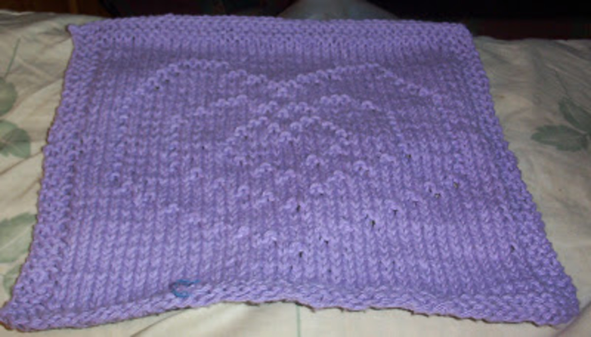 A beautiful purple heart pattern, but you can knit it for your sweetie in whatever color you desire!