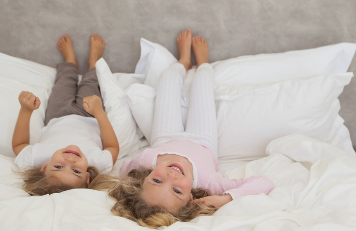 Happy Children lying on the Bed