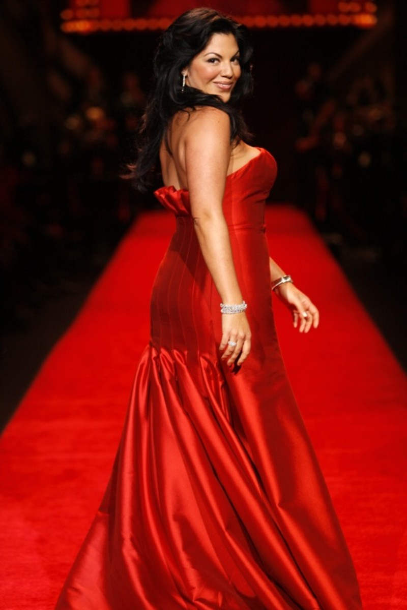 Sara Ramirez modeling at the Red Dress Collection charity fashion show to benefit The Heart Truth.