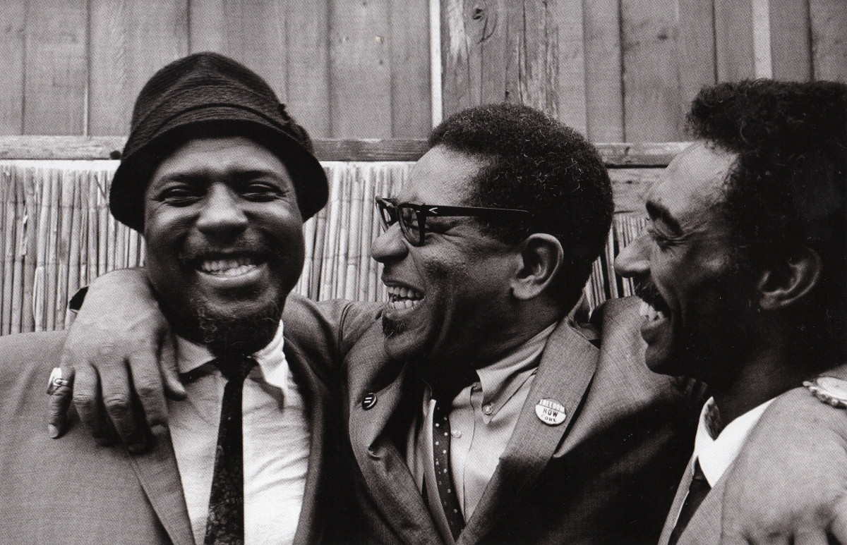 Monk, Dizzy Gillespie, and Gerald Wilspn backstage at the Monterey Jazz Festival, 1963.