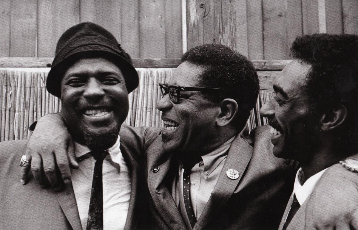 Monk, Dizzy Gillespie, and Gerald Wilspn backstage at the Monterey Jazz Festival, 1963.
