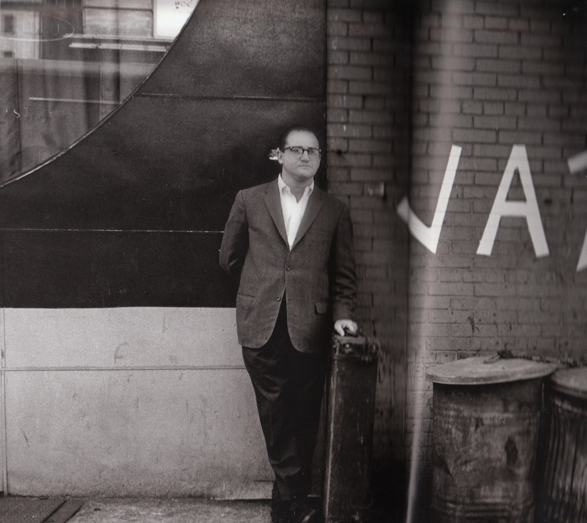 Al Cohn behind a club, New York City, 1963.