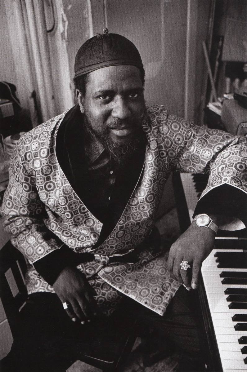 Monk photographed for a Saturday Evening Post Feature in 1963, and Monk is sitting next to his piano dressed in a silk robe.