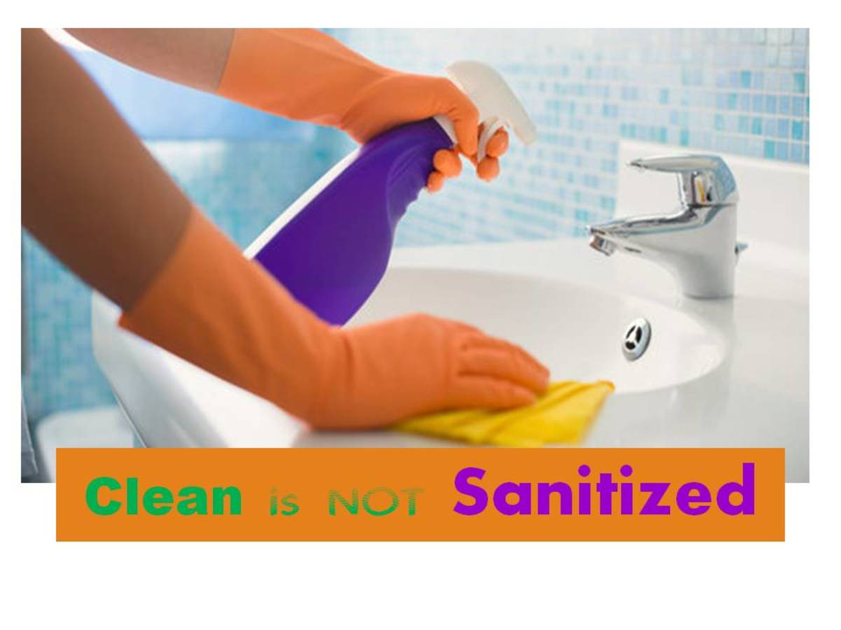 "colorful poster with orange rubber gloves and purple spray bottle with the words ""clean is not sanitized"""