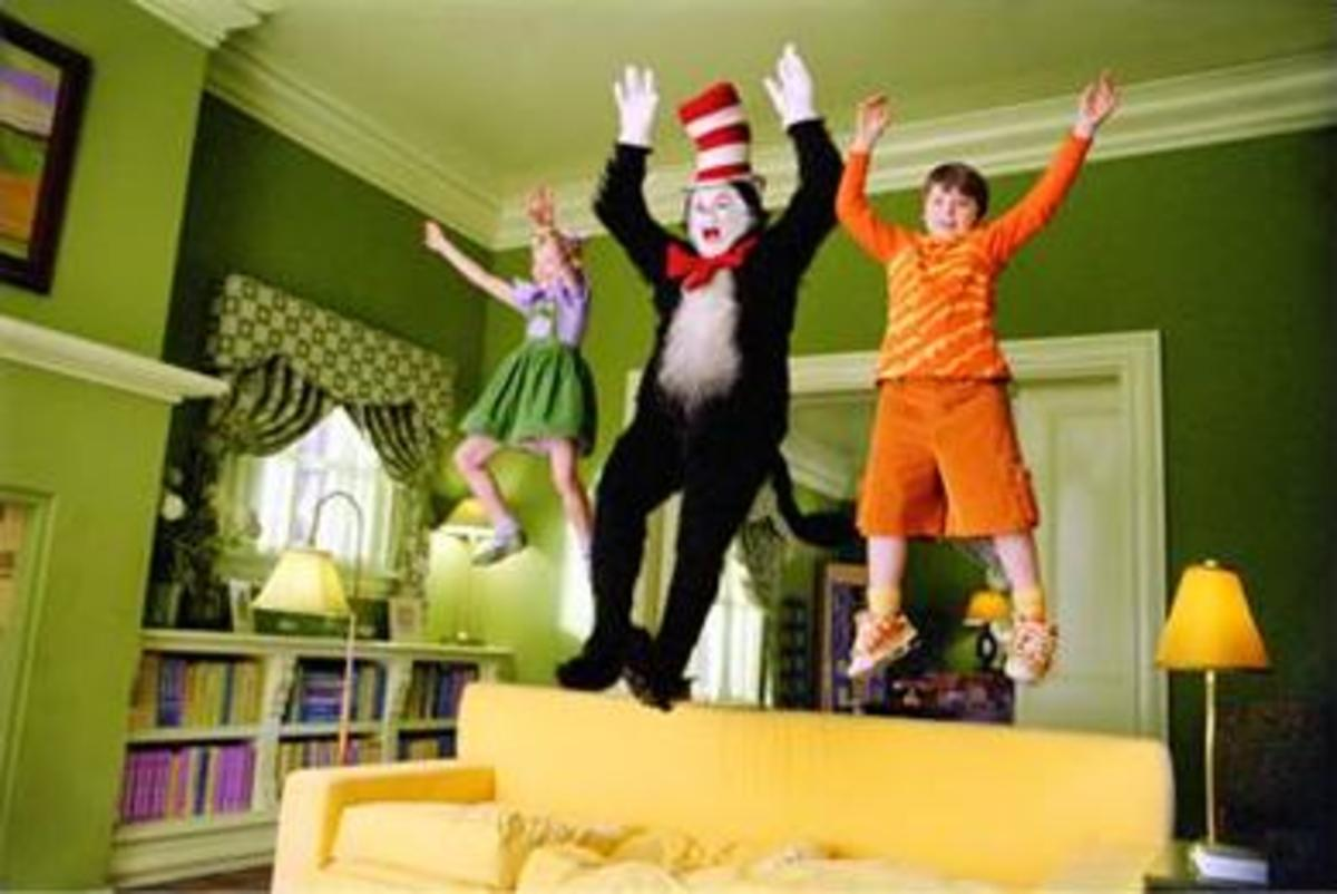 Sally, The Cat in The Hat, and Conrad jump on the couch in The Cat in The Hat the movie.