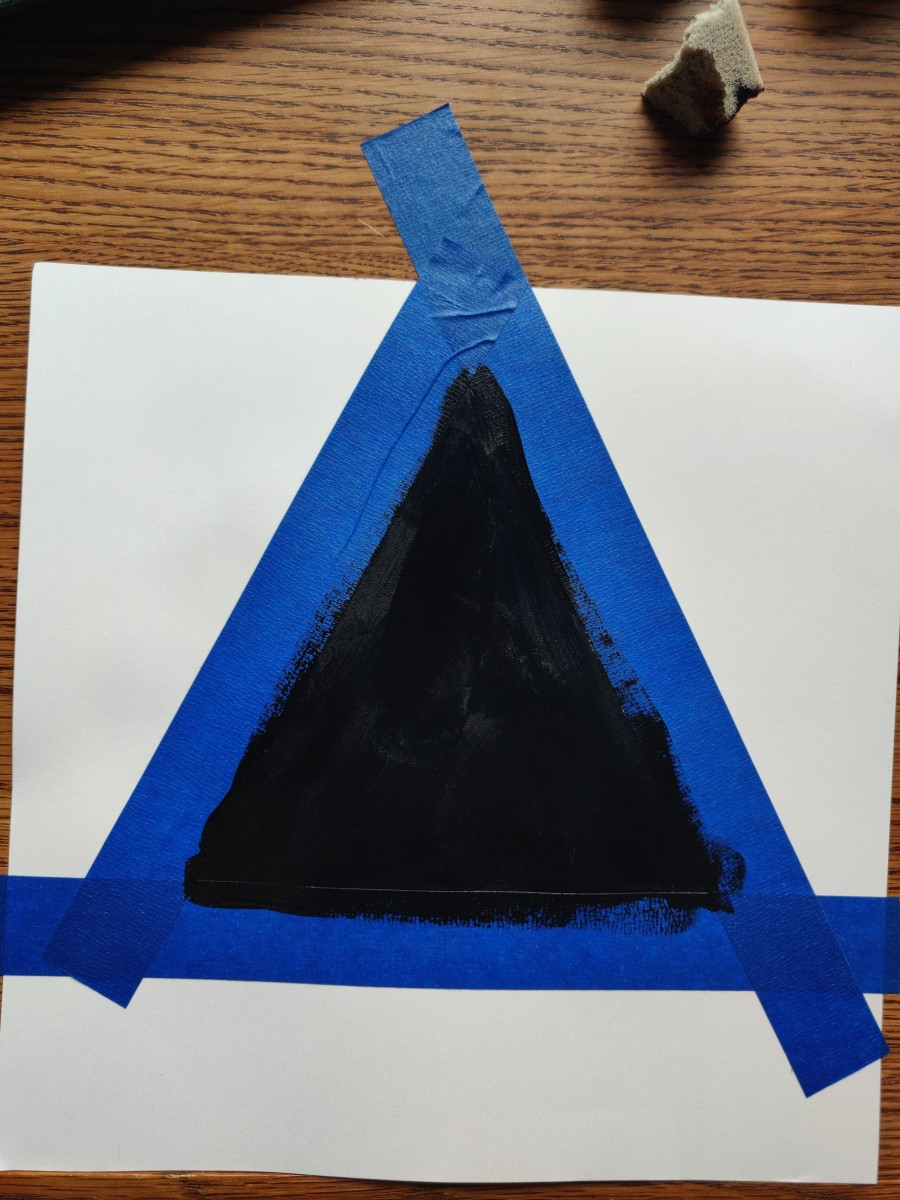 Fill in the triangle with black paint