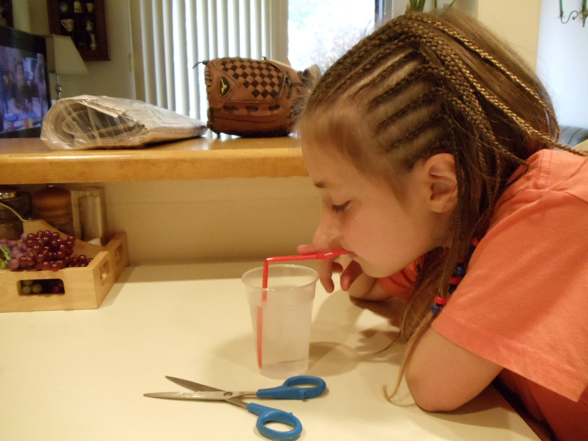 Blow through the long section of the straw.