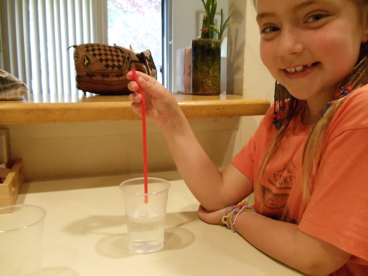 Put the straw into the glass of water