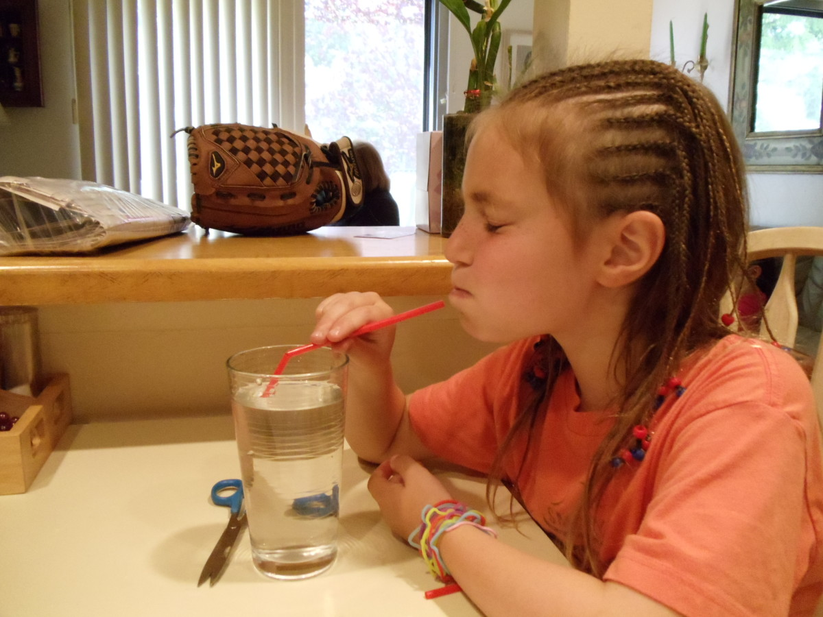 BLOW Through the straw as hard as you can in this experiment.