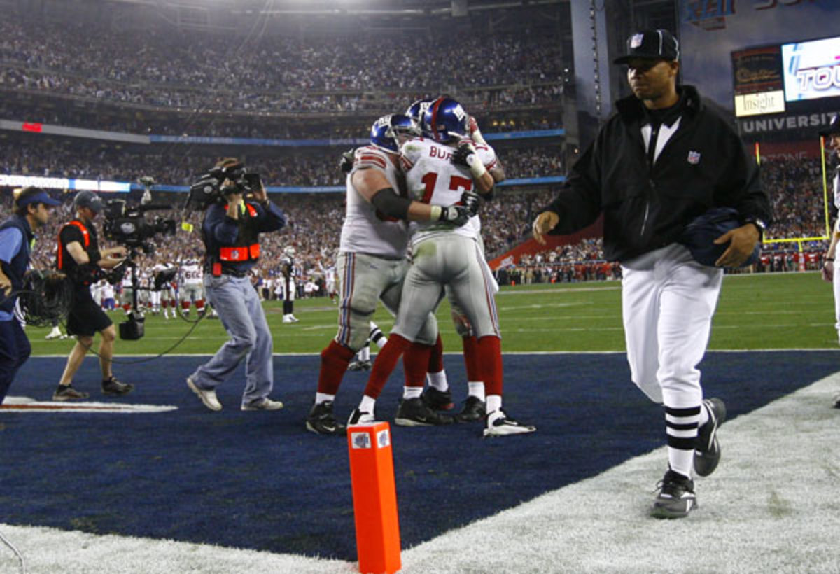 Giants Plaxico Burress #17 and teammates celebrate his game winning touchdown catch against the Patriots during Super Bowl XLII at the University of Phoenix Stadium on February 3, 2008 in Phoenix, Arizona. Photo by Ben Liebenberg / NFL.com.