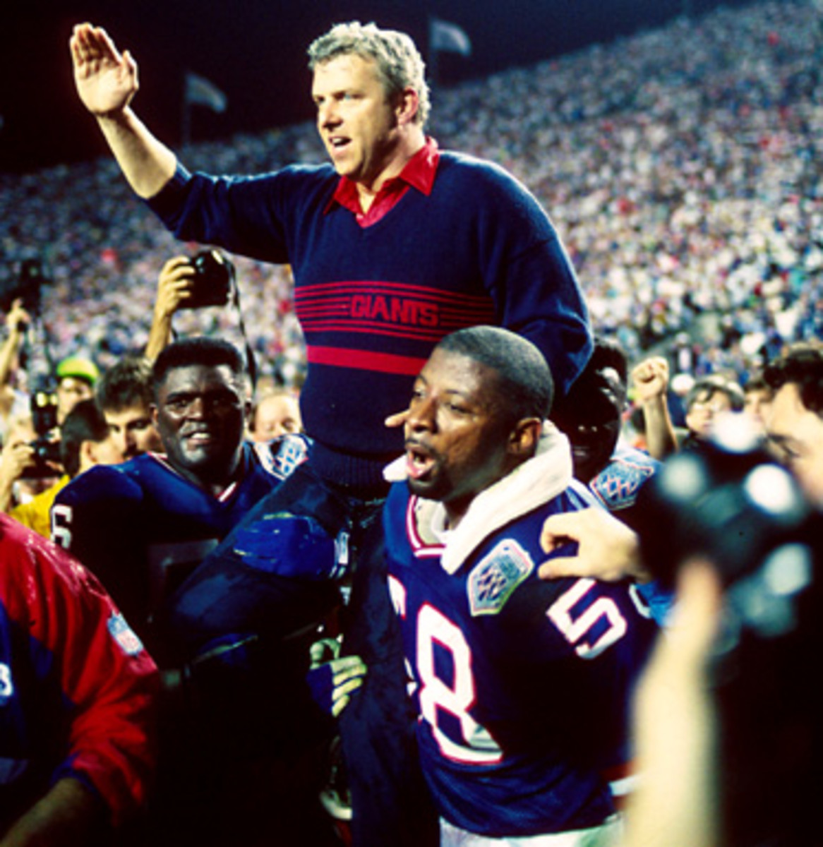 Head coach Bill Parcells of the New York Giants is carried off the sideline by Carl Banks, Lawrence Taylor, and others after a 20 to 19 win over the Buffalo Bills - Super Bowl XXV - Jan 27, 1991 Michael Zagaris/Getty Images