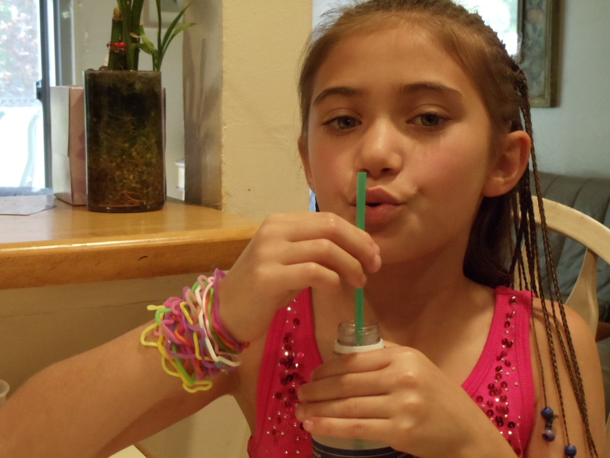 See what happens to the sound when you lower the straw