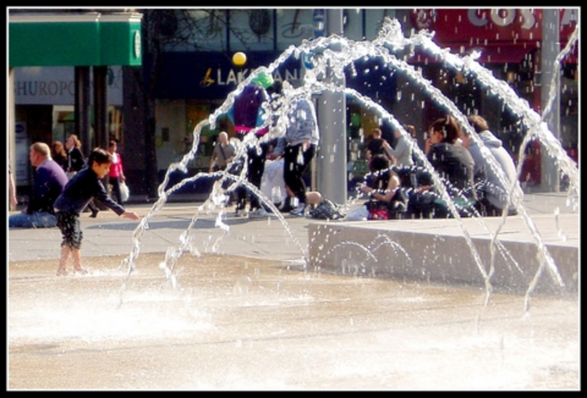 'Boys will be boys' - Playing in the water feature of the Market Square