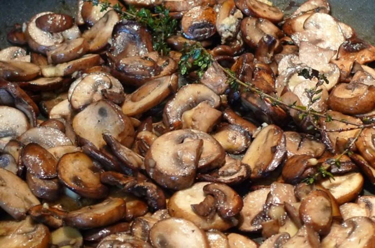 Sauteed Mushrooms with fresh sprigs of thyme will go excellent with your rib eye steaks.