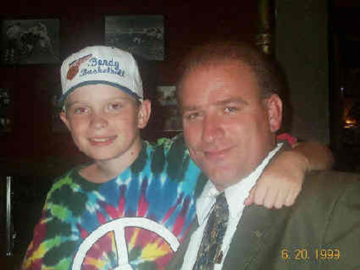 Clark and older son Layne after the accident during the late 1990's
