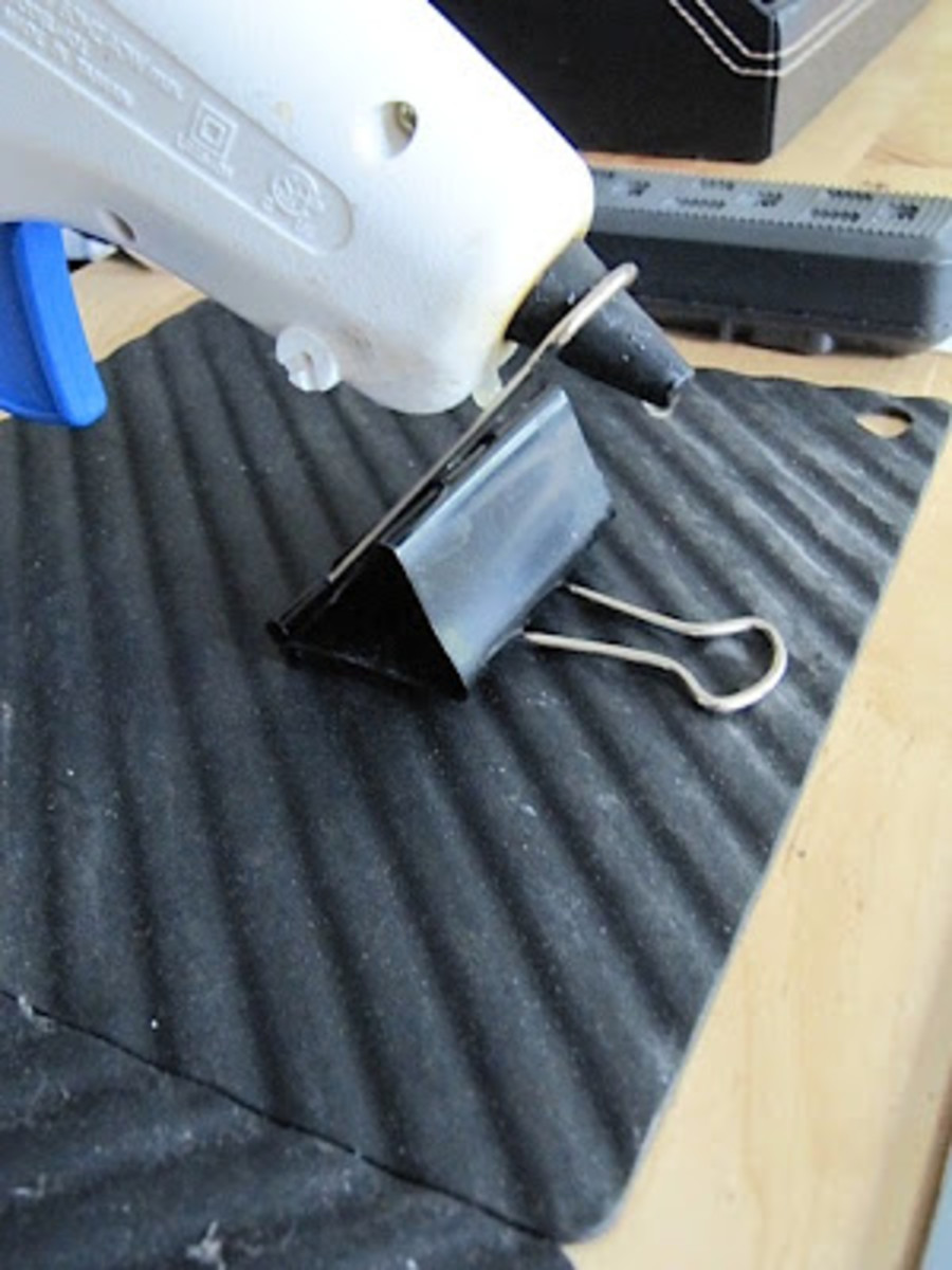 A binder clip can be used to hold your glue gun off your surface