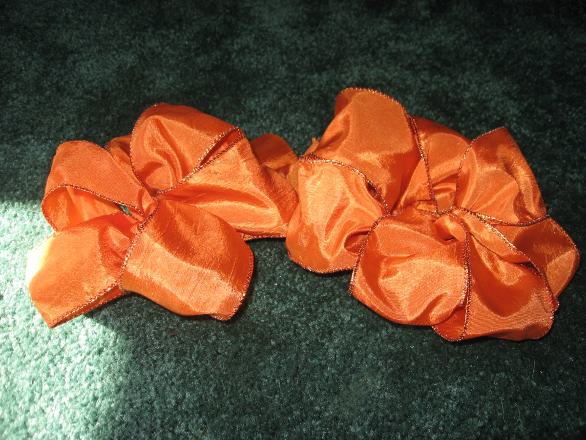 "One ribbon bow with 8"" lengths, one with 10"" lengths."