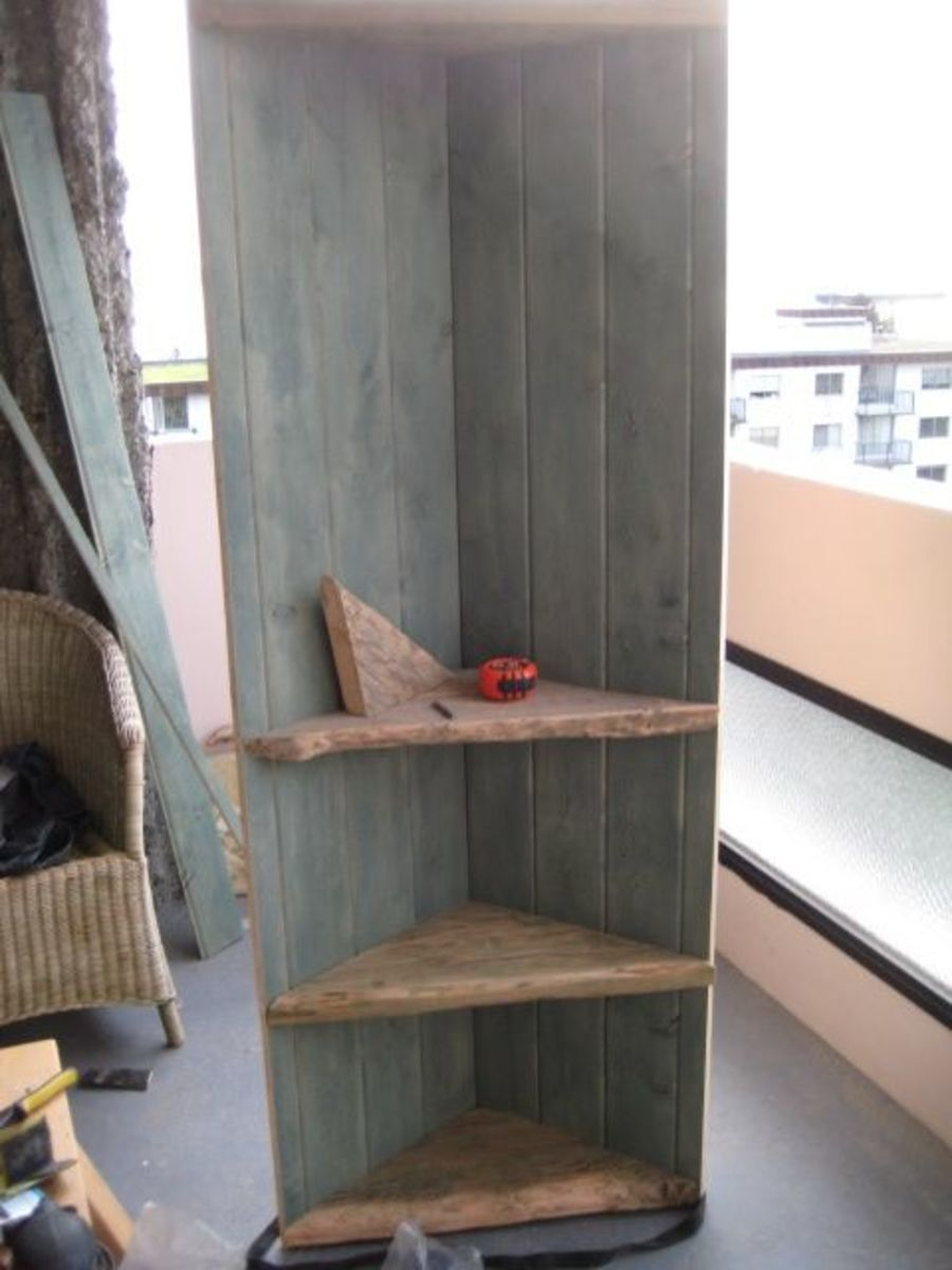 Build a corner shelf from reclaimed wood hubpages for Build your own corner bookcase