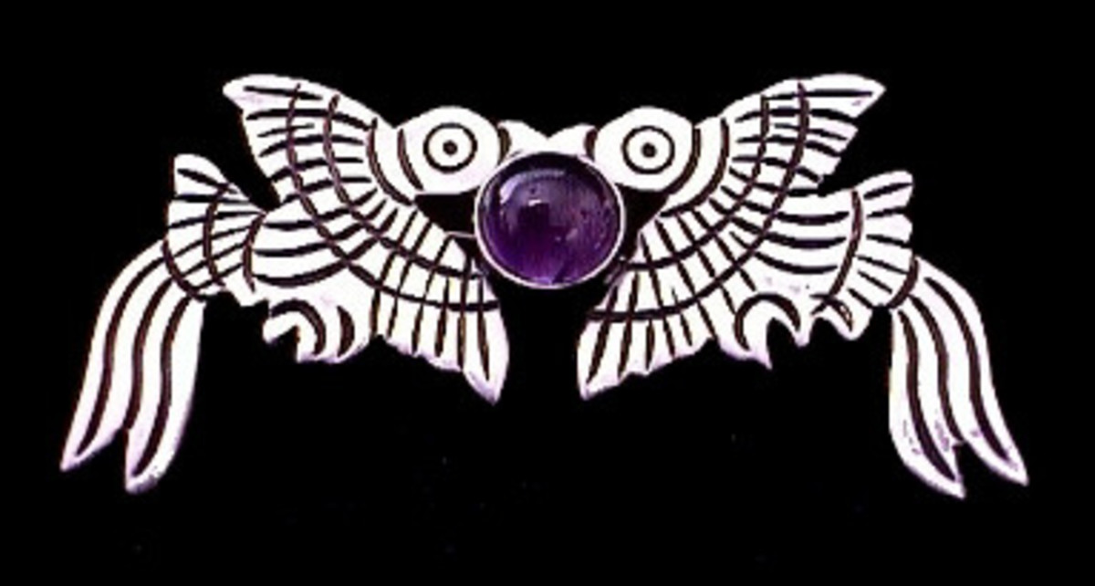 silver and amethyst fish pin