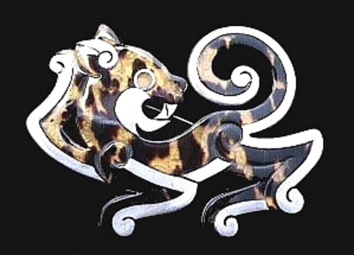 Silver and tortoiseshell jaguar