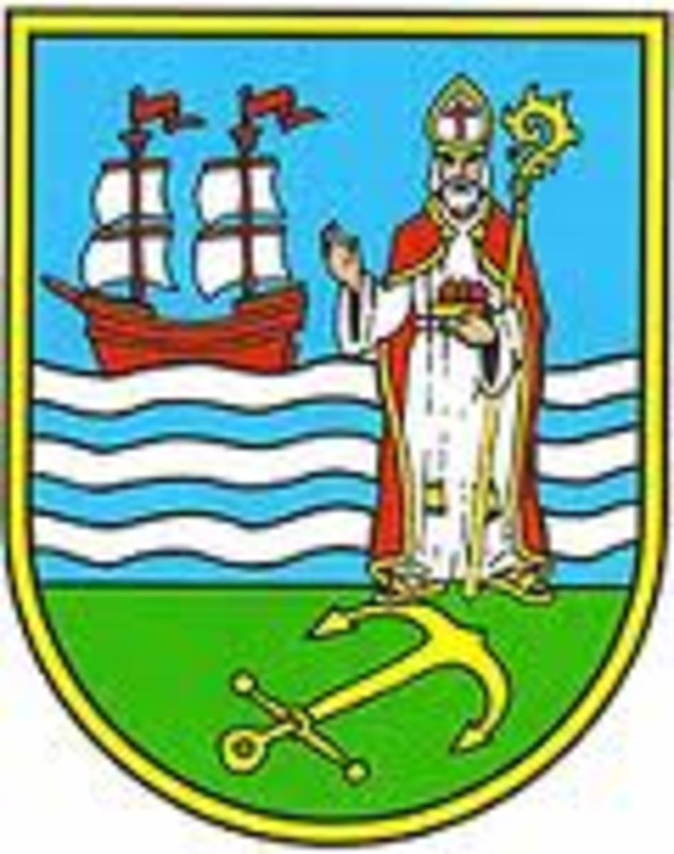 This is the city seal of Komiža, where Saint Nikola is the patron saint, celebrated on 6 December.  He is the protector of both children and fishermen.