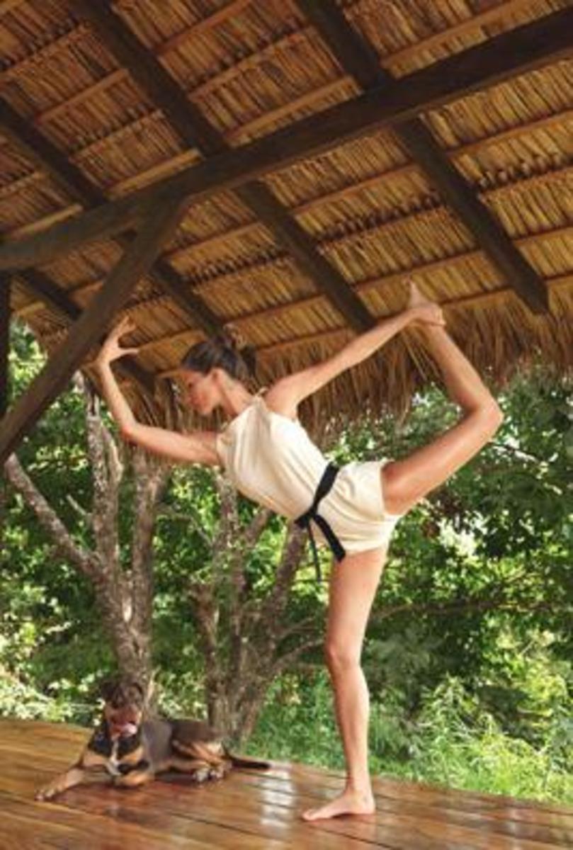 Super model Gisele Bundchen does yoga pose.