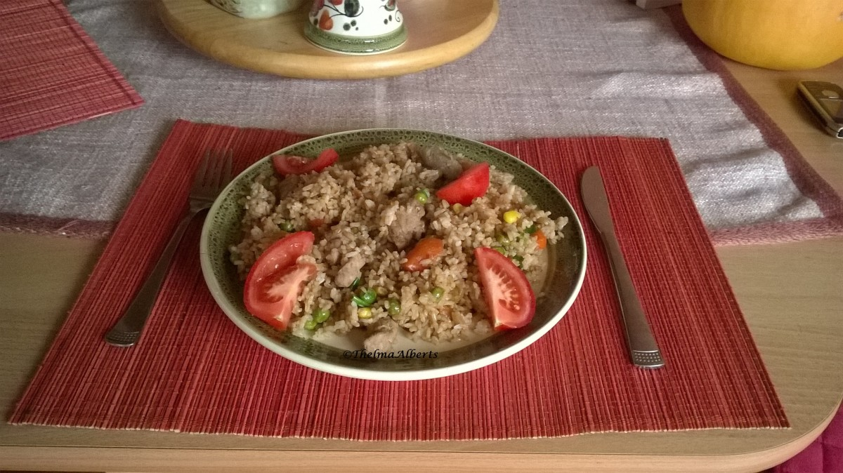 Fried rice with pork strips and veggies for lunch.