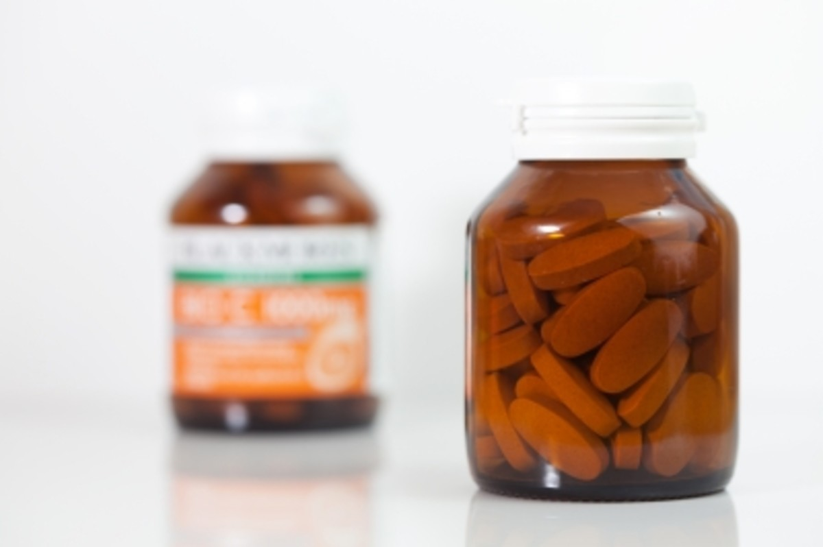 Vitamin and medicine labels show artificial dyes approved by the FDA.