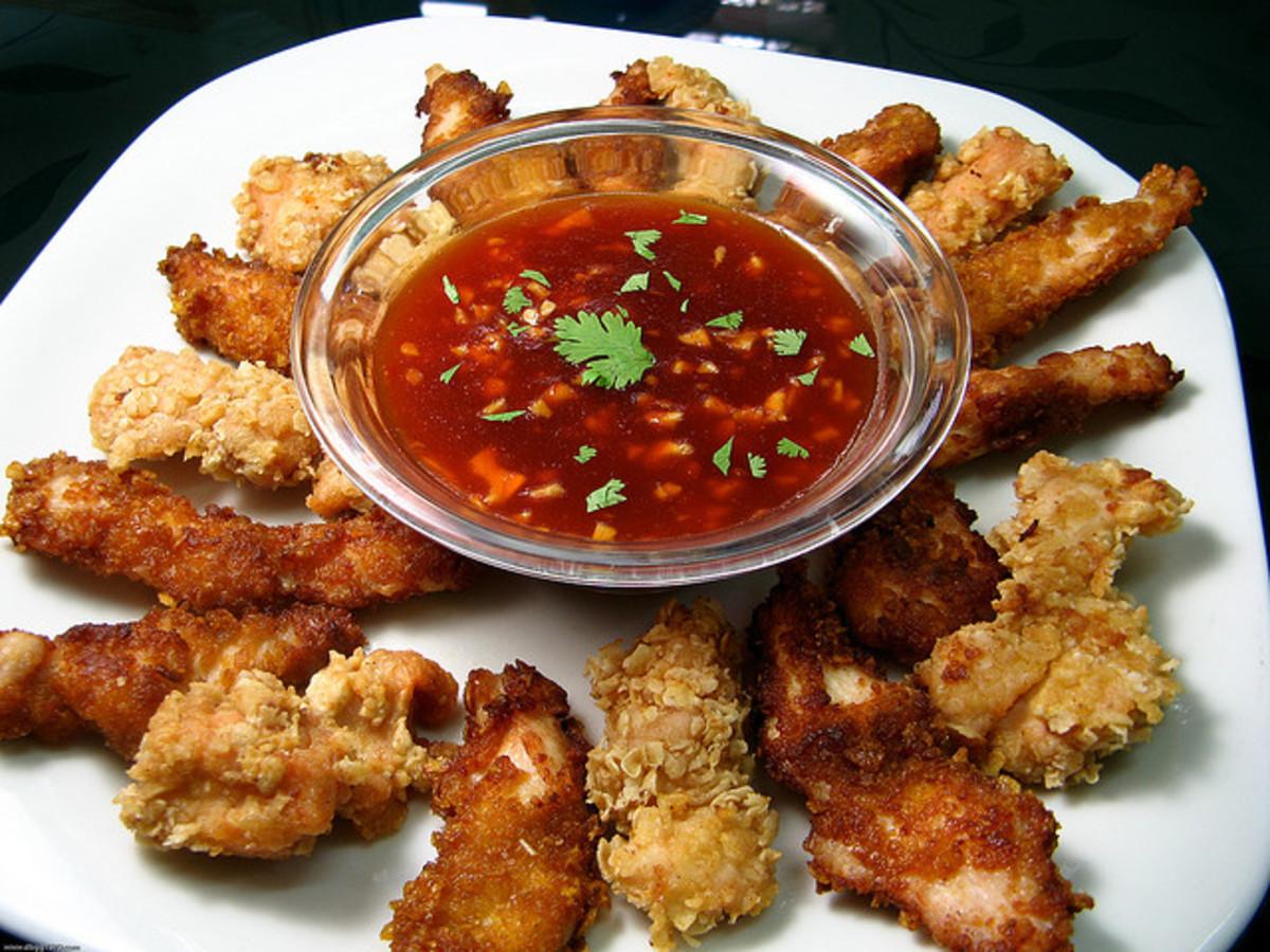 Flatten chicken with the meat mallet to make chicken strips.