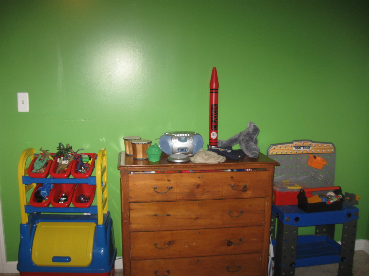 Here's another part of our four year old's room. Bright Green in a Semi Gloss Paint, Vibrant Orange, Yellows, and Blues make this little boy's room awesome!