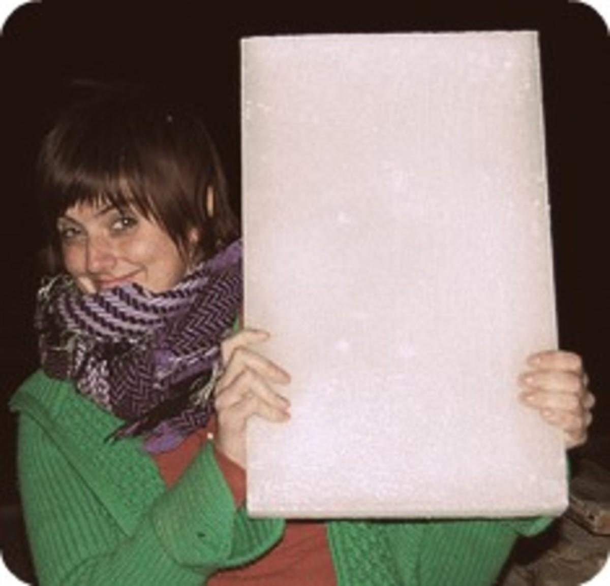 Mischievous person wielding a block of wax