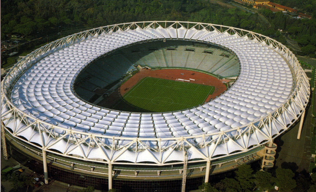 Temporary home of the Italian Rugby team: the 72,698 capacity Stadio Olimpico. The Italian Team will be based here (probably until 2014) until the Stadio Flaminio has had its capacity increased to 42,000