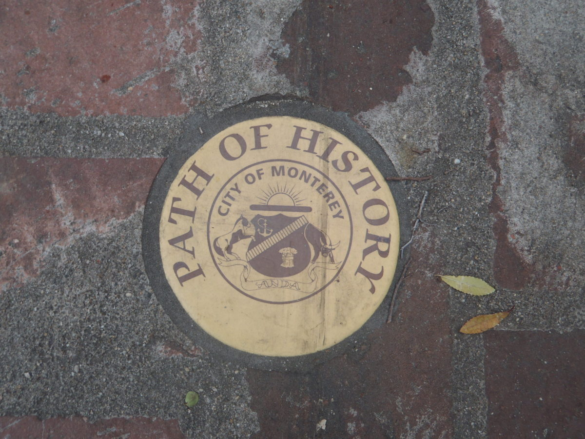 'Path of History' marker along sidewalk.