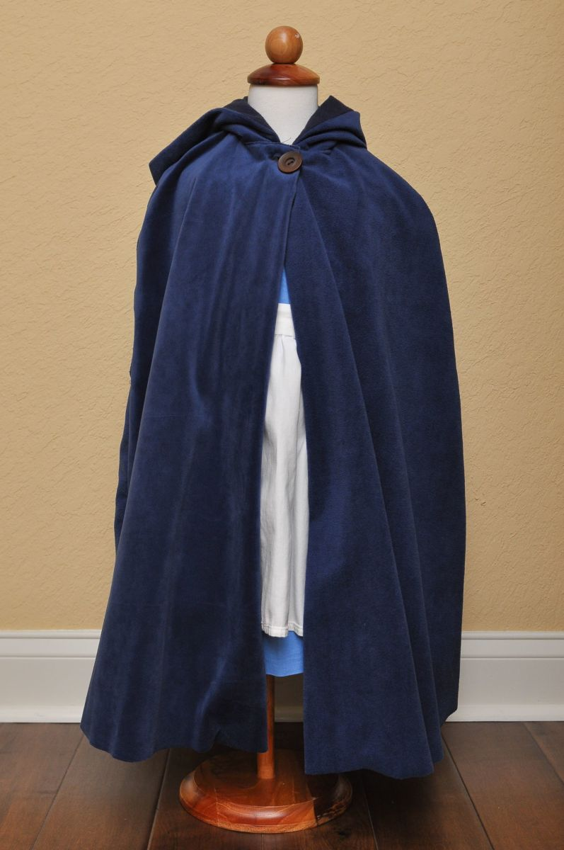 Blue cape. Standard pattern - no adjustments needed. Used velour on the outside, and blue flannel on the inside for warmth.