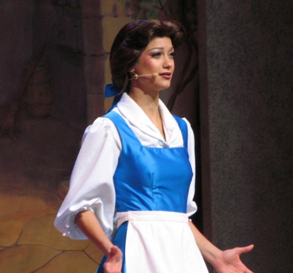 Here's a shot from the Beauty and the Beast show at Disney's Hollywood Studios in Florida. The theme-park implementation of this dress is rather flashy. They use a very bright shade of blue in a shiny fabric that appears to be some kind of satin.  Th