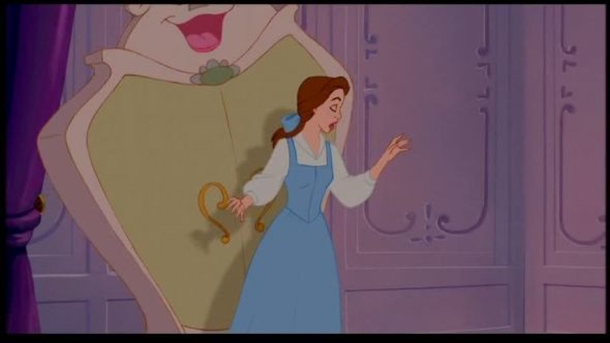 This shot shows Belle's dress without the apron.  Reveals a V-front to the bodice, as opposed to the more rounded look given while wearing the apron.
