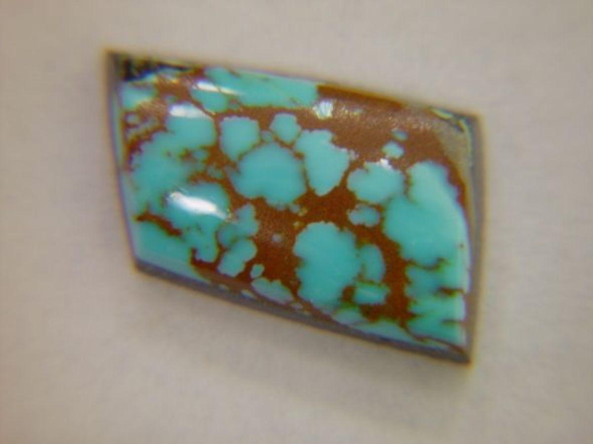 Aqua-colored Number 8 with a desert-floor colored matrix.