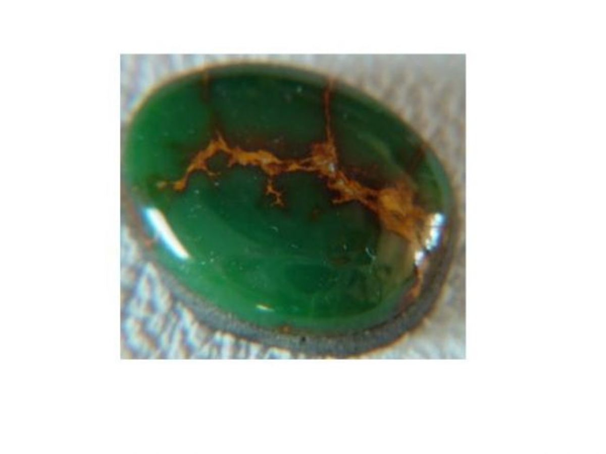 Cerrillos turquoise in grass-green with buckskin-colored matrix.