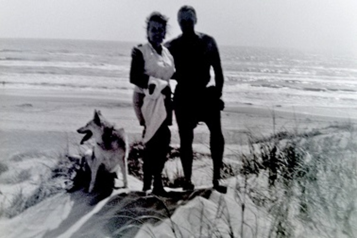 My parents with Sheba on top of a sand dune with Gulf of Mexico in background