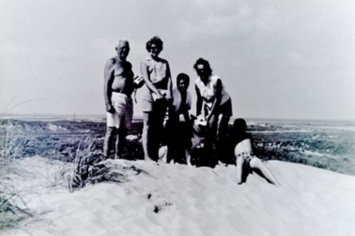 My grandpa, mother and we 3 kids on a Padre Island sand dune.