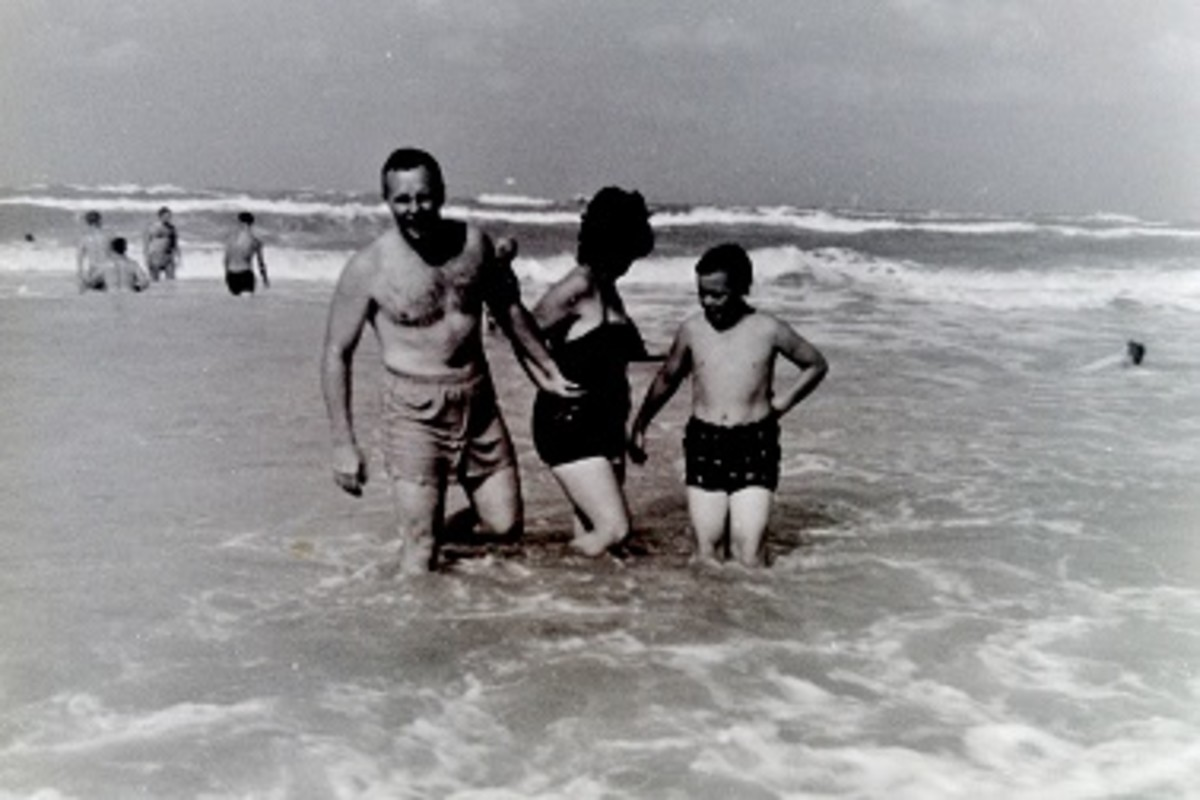 My dad, mother and brother John in the water.
