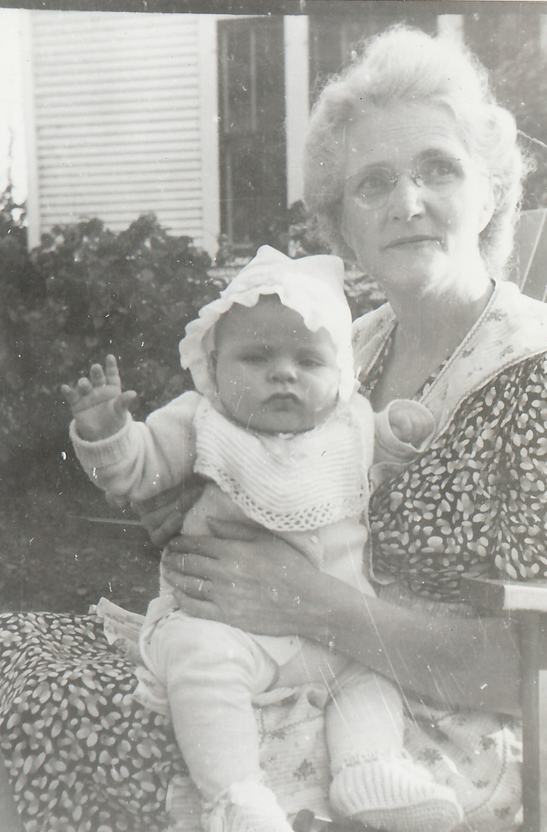 My paternal grandmother holding me as a child