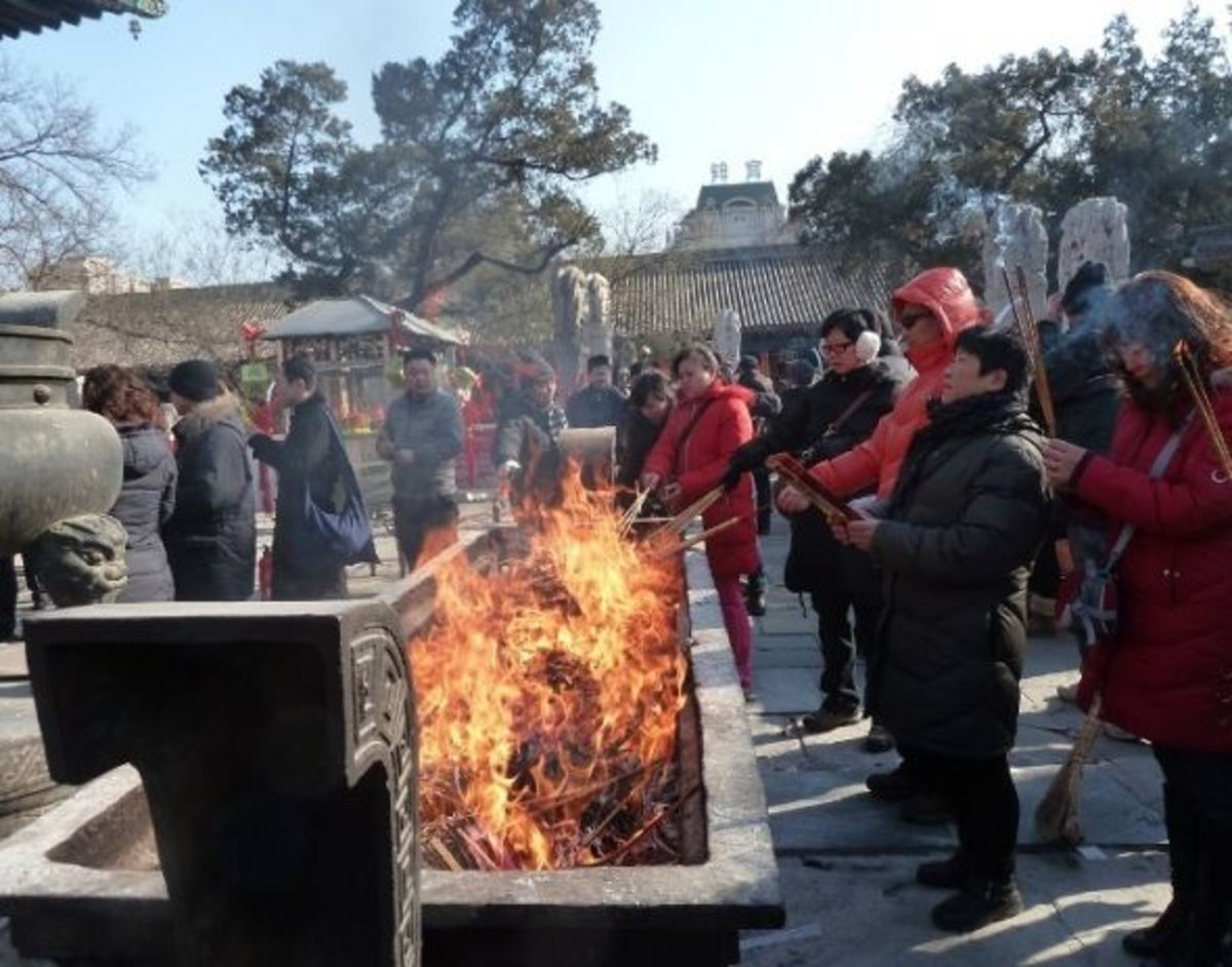 During Chinese New Year people like to visit a local temple and burn incense to greet the new year.  The incense burners can get really full at that time.