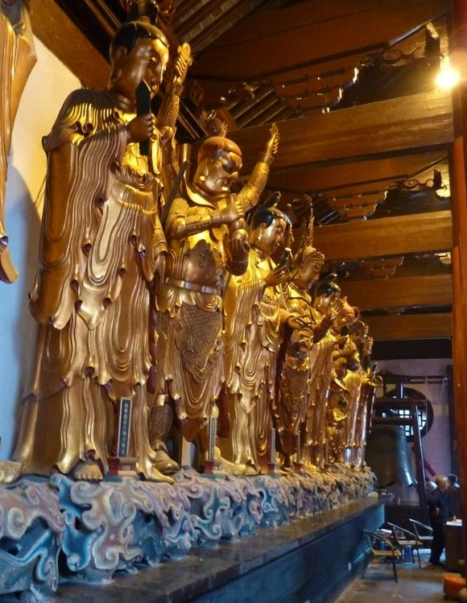 "There were 16 ""saints"" when Buddhism came to China from India, but over time China added two more of their own, and now there are 18 Luohan - Saints.  They are shown surrounding the Buddhas in the main hall of the temple, and like the saints of Chris"