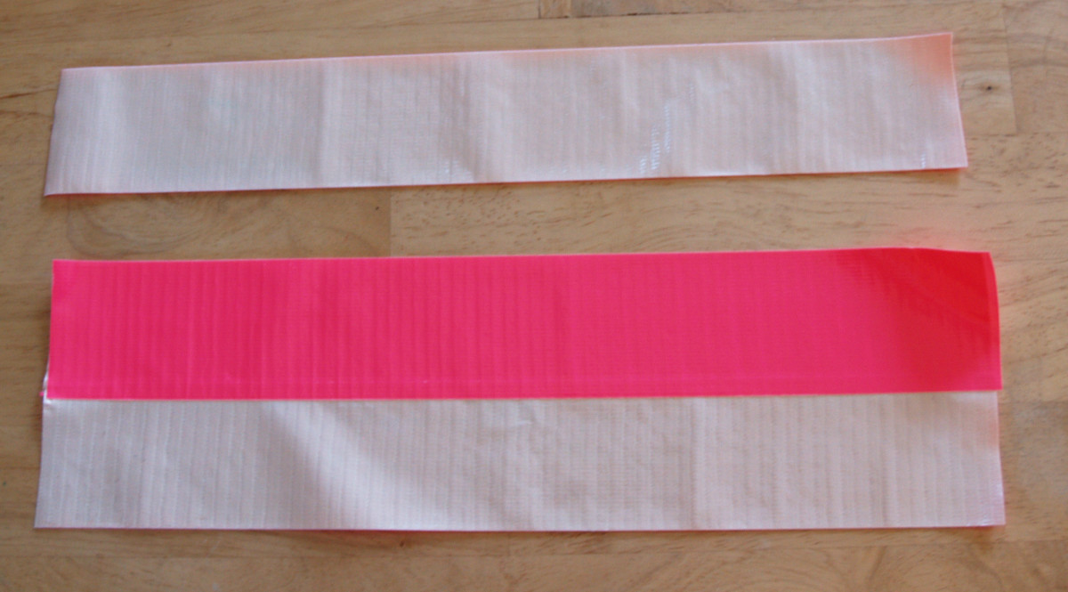 "Place the third strip of Duck® Tape sticky side down on top of the piece of ""overlapped"" tape."