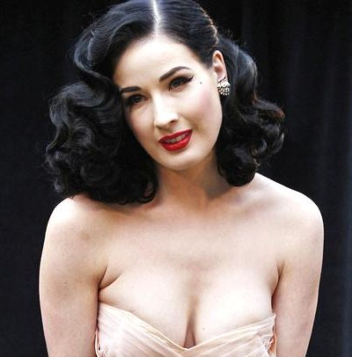 Dita Von Teese in a cherry red lipstick color.