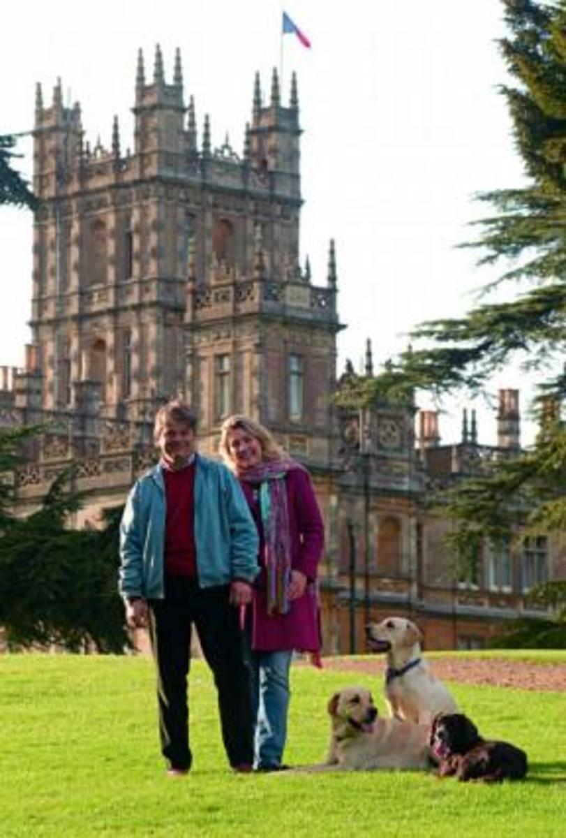 The Carnarvons outside their ancestral home, Highclere Castle