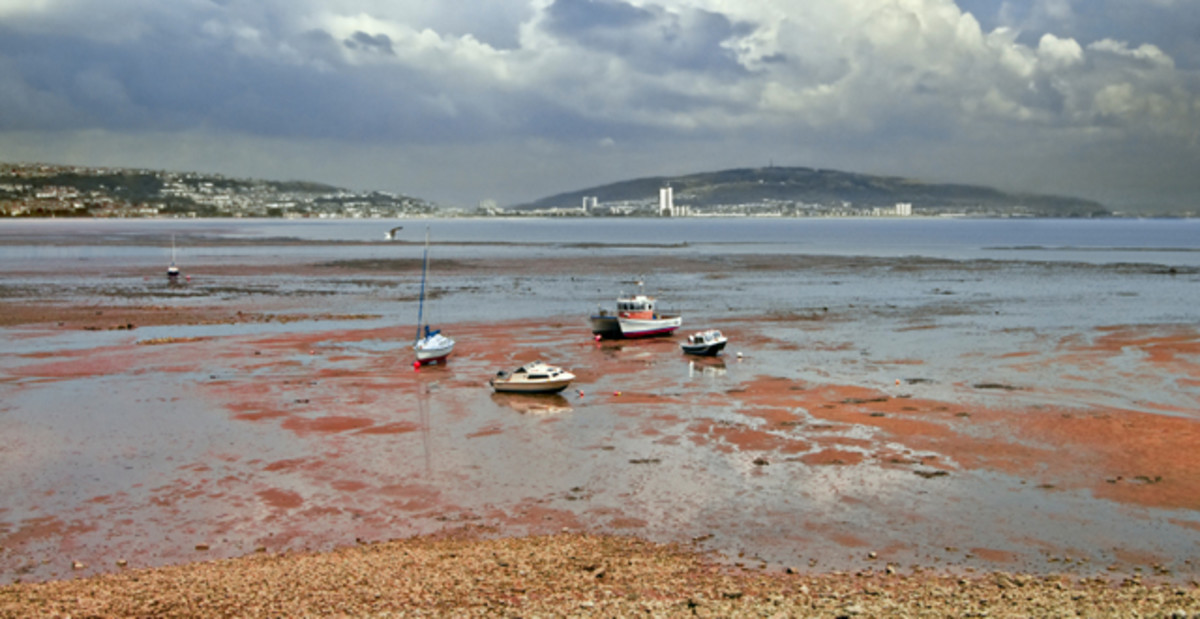 Swansea Bay at low tide. Svein  Haraldsson established a settlement on the island in the Tawy after his ship suffered damage in the Bristol Channel